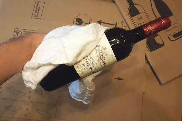 Livraison de vin en France - Contrôle de qualité des bouteilles avant expédition - Tastavin